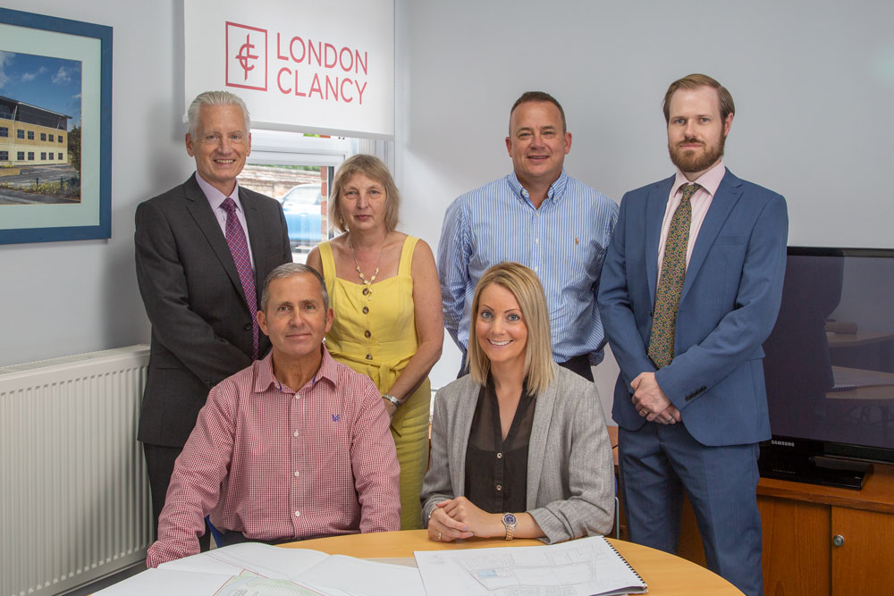 Sarah Bruce MRICS, MSc BSc Hons, the new surveyor of the Management and Professional Department of London Clancy with her colleagues. Back Row from left, Mark Clancy, Tracy Cox Gary Gibbons, Keith Enters. Front Row from left, Mark Everett and Sarah Bruce.